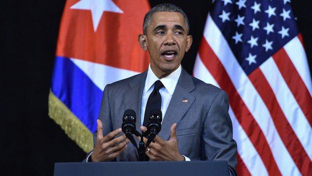 """US-Präsident Barack Obama fordert, dass """"die Welt zusammenstehen muss"""". (Bild: APA/AFP/NICHOLAS KAMM)"""