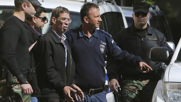 Der Entführer nach seiner Verhaftung (Bild: AP)