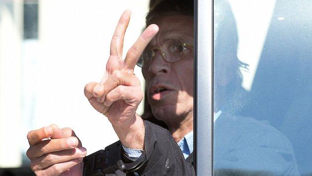 Der Entführer nach seiner Verhaftung (Bild: APA/AFP/GEORGE MICHAEL)