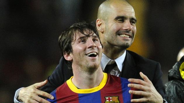 Pep Guardiola (rechts) mit Lionel Messi (Bild: JAVIER SORIANO / AFP / picturedesk.com)