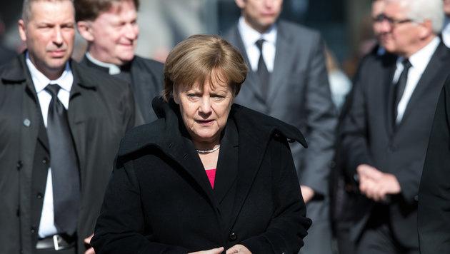 Angela Merkel bei der Trauerfeier f�r Westerwelle (Bild: APA/dpa/Federico Gambarini)