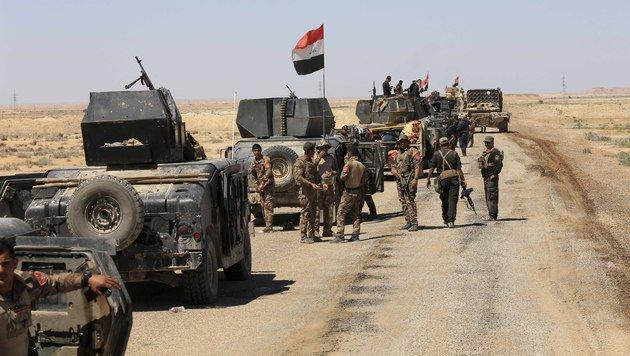 Irakische Einheiten im Kampf gegen den IS (Bild: Associated Press)