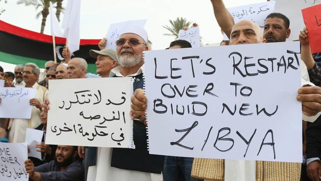 Anhänger der Einheitsregierung in Tripolis hoffen auf einen Neustart. (Bild: AFP)