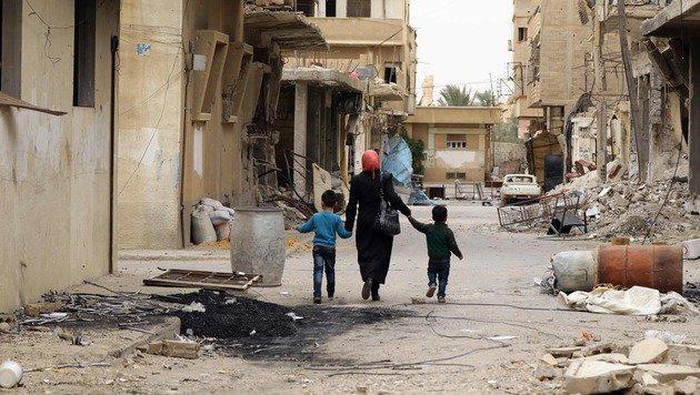 Rückkehr in die vom IS gepeinigte Oasenstadt Palmyra (Bild: APA/AFP/LOUAI BESHARA)