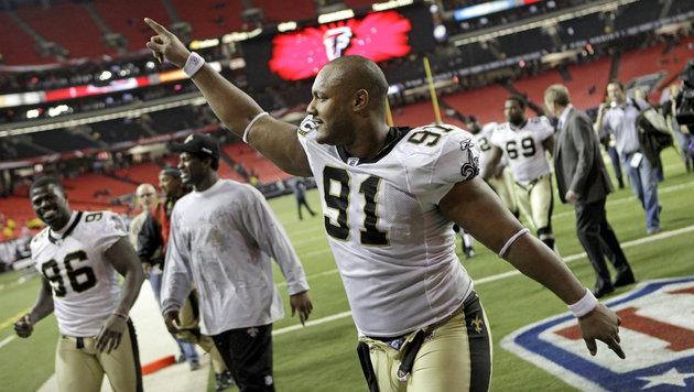 Will Smith (Nummer 91) nach einem Sieg seiner New Orleans Saints im Jahr 2010 (Bild: AP)