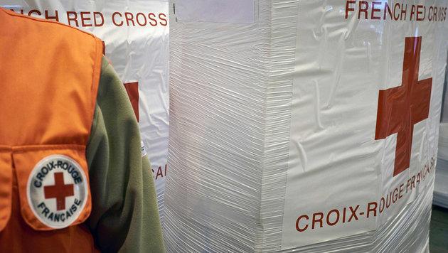 Scheinfirmen: Rotes Kreuz als Tarnung missbraucht (Bild: APA/AFP/JEAN-PHILIPPE KSIAZEK)