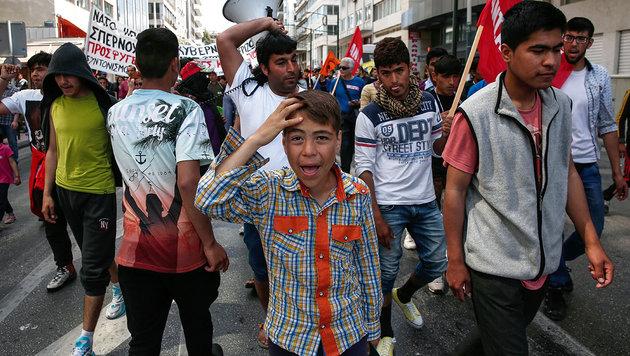 Fl�chtlingsprotest im Hafen von Pir�us (Bild: ASSOCIATED PRESS)