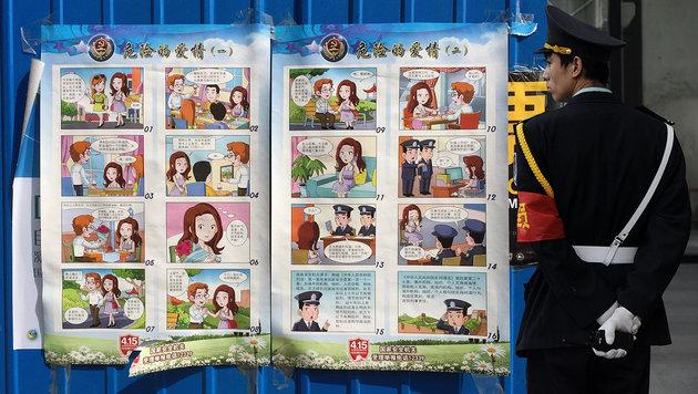 """Comic in China warnt vor """"h�bschen Ausl�ndern"""" (Bild: ASSOCIATED PRESS, APA/AFP/WANG ZHAO)"""