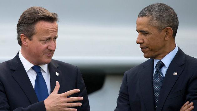 Sch�tzenhilfe f�r David Cameron vom transatlantischen Partner Barack Obama (Bild: ASSOCIATED PRESS)