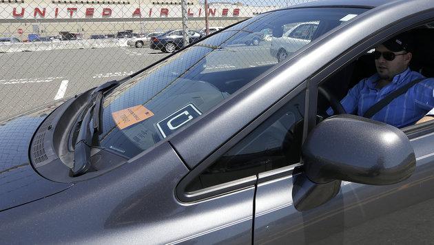 Uber will Streit mit 100-Millionen-Zahlung beenden (Bild: AP)