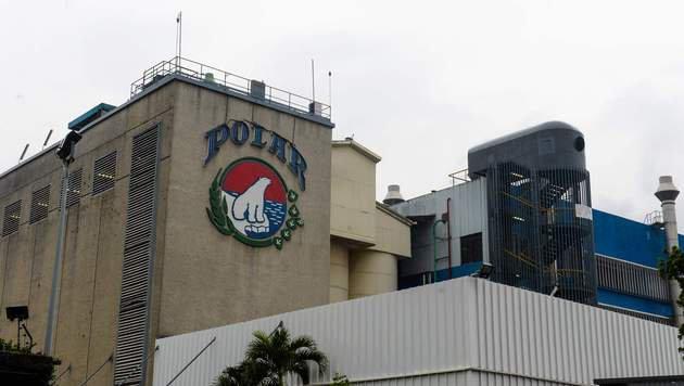 Schwere Zeiten für den venezolanischen Bierproduzenten Polar (Bild: APA/AFP/FEDERICO PARRA)