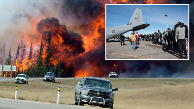 Tausende Menschen wurden auch über eine Luftbrücke vor dem Flammenmeer in Sicherheit gebracht. (Bild: ASSOCIATED PRESS, EPA)