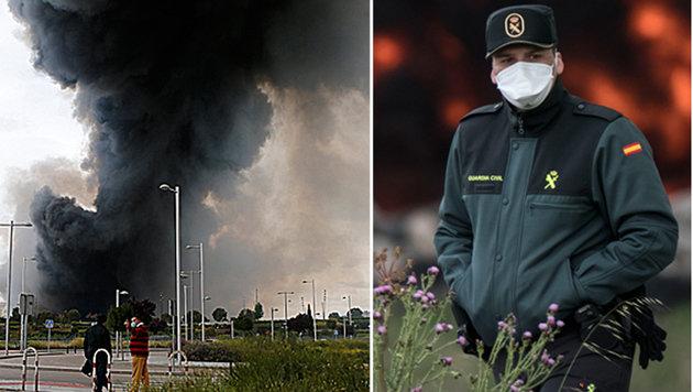 Menschen sind in der N�he der Deponie derzeit nur mit Schutzmaske zu sehen. (Bild: ASSOCIATED PRESS, APA/AFP/PEDRO ARMESTRE)