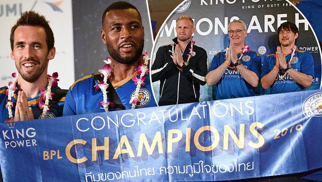 Fuchs und Leicester lassen sich in Bangkok feiern (Bild: APA/AFP/LILLIAN SUWANRUMPHA)
