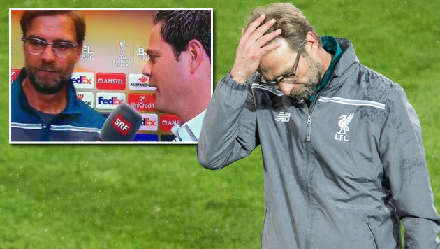 "Reporter ärgert Star-Coach: ""Kopf oder Klopp hoch"" (Bild: ASSOCIATED PRESS, YouTube.com)"