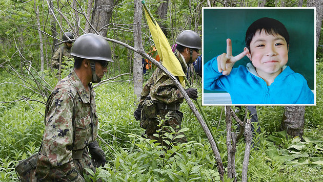 Yamato Tanooka (kl. Bild) wurde unverletzt wiedergefunden. (Bild: APA/AFP/JIJI PRESS, ASSOCIATED PRESS)