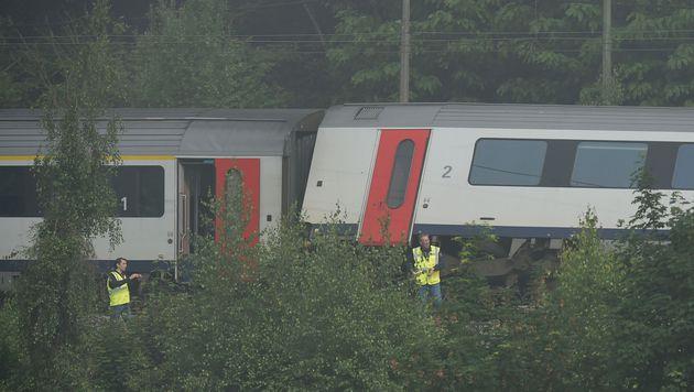 Belgien: Zugunglück womöglich von Blitz verursacht (Bild: APA/AFP/JOHN THYS)