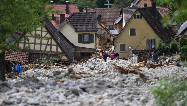 Ort nach Überschwemmung fast völlig unter Wasser (Bild: APA/dpa/Marijan Murat)