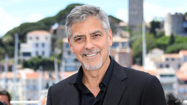 George Clooney produziert neue Serie von Hit-Duo (Bild: APA/AFP/ANNE-CHRISTINE POUJOULAT)