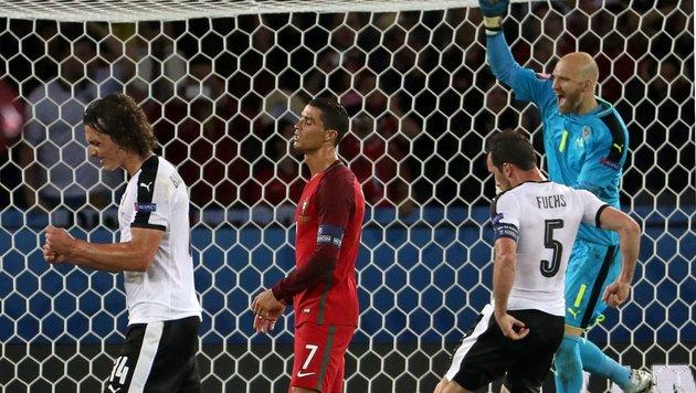 Spinnenmann Almer rettet Remis gegen Portugal! (Bild: APA/AFP/KENZO TRIBOUILLARD)