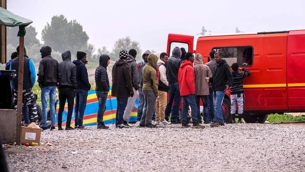 Flüchtlinge in Calais (Bild: AFP)
