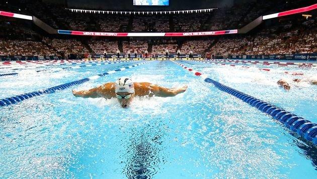 Phelps siegt im 200-m-Lagen-Duell mit Lochte (Bild: APA/AFP/GETTY IMAGES/AL BELLO)