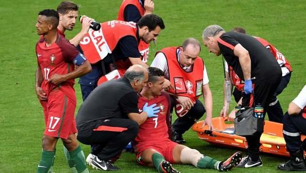 Das Ronaldo-Drama: Nach Payet-Foul verletzt out (Bild: AFP or licensors)