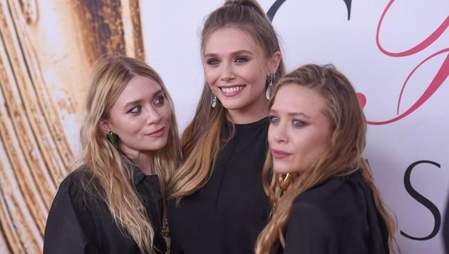 Familienbande: Elizabeth Olsen (Mitte) mit ihren Schwestern Mary-Kate und Ashley Olsen (Bild: AFP)