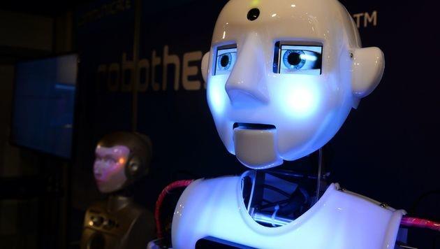 Deutscher Post-Chef schlägt Robotersteuer vor (Bild: AFP)