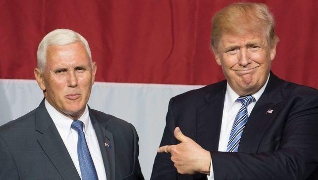US-Präsidentschaftsbewerber Trumpjolt Indiana-Gouverneur Mike Pence (li.) mit ins Boot. (Bild: AFP)