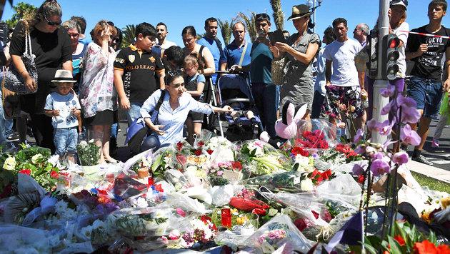 Um diese Menschen trauert die ganze Welt (Bild: APA/AFP/ANNE-CHRISTINE POUJOULAT)