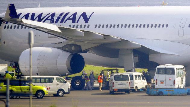 Japan: Acht von zehn Reifen bei Airbus geplatzt (Bild: AP/Hiroki Yamauchi/Kyodo News)