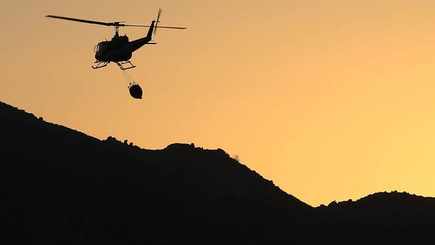 Löscharbeiten behindert: US-Drohnenpilot verhaftet (Bild: AP)