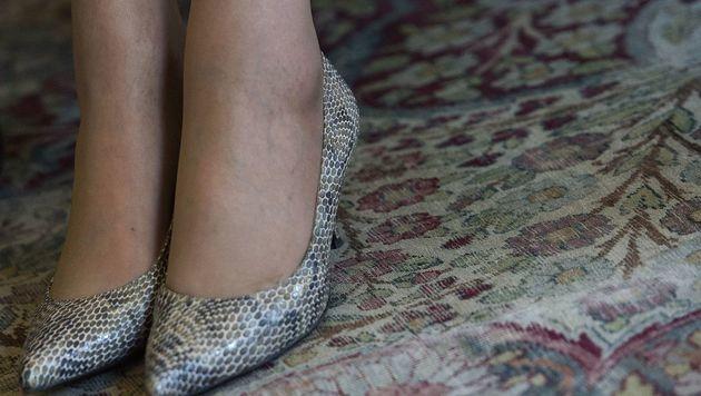 Auch Schuhe mit Schlangenmuster werden getragen. (Bild: AFP)