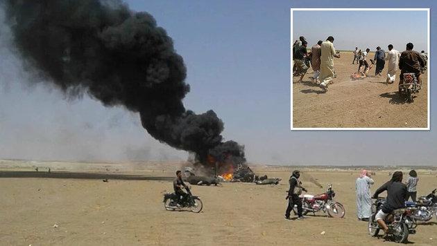 Auf Twitter wurden diese Bilder vom brennenden Wrack und einer Leiche gepostet. (Bild: twitter.com/Terror Monitor)