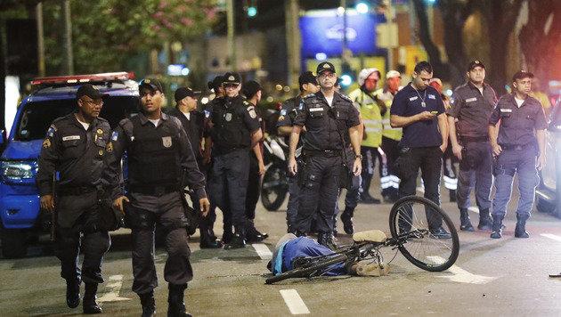 Zwei Menschen bei Olympiastätten erschossen (Bild: AP)