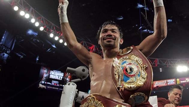 Manny Pacquiao steigt wieder in den Ring (Bild: APA/AFP/JOHN GURZINSKI)