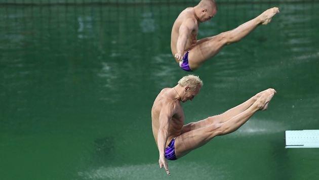 Grünes Olympia-Wasser: Chemikalien sind schuld (Bild: APA/AFP/GABRIEL BOUYS)