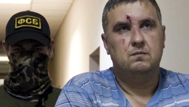 Dieser Mann wurde als einer der Saboteure vorgeführt. (Bild: AP)