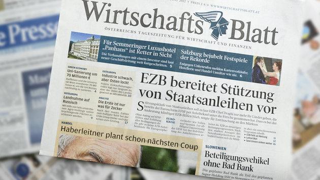 Mitarbeiter überlegen neue Wirtschaftszeitung (Bild: APA/Herbert Neubauer)