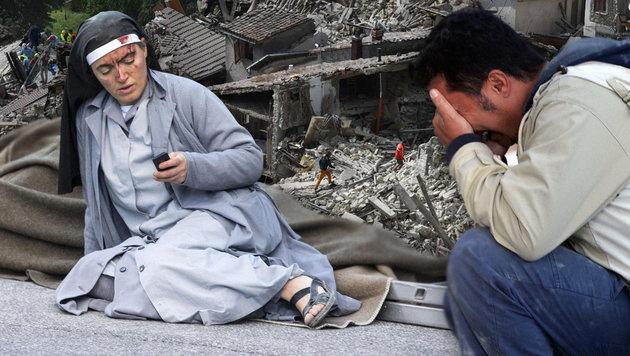 """Opfer: """"Zehn Sekunden haben hier alles zerstört"""" (Bild: Crocchioni, AP, AFP/FILIPPO MONTEFORTE)"""