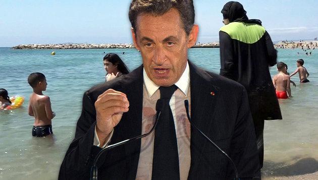 Frankreich: Auch Sarkozy heizt Burkini-Streit an (Bild: ASSOCIATED PRESS, APA/AFP/BERTRAND LANGLOIS)