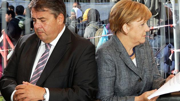 SPD-Chef Sigmar Gabriel, Kanzlerin Angela Merkel (Bild: APA/BARBARA GINDL, AP)
