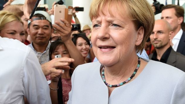 Merkel bleibt auf Kurs - und will erneut antreten (Bild: APA/AFP/dpa/RAINER JENSEN)