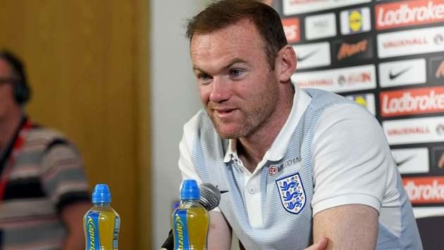Rooney bleibt Kapitän - Rücktritt nach WM 2018 (Bild: APA/AFP/ANTHONY DEVLIN)