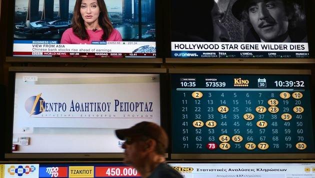 Umstrittene TV-Lizenz-Auktion in Athen gestartet (Bild: AFP)