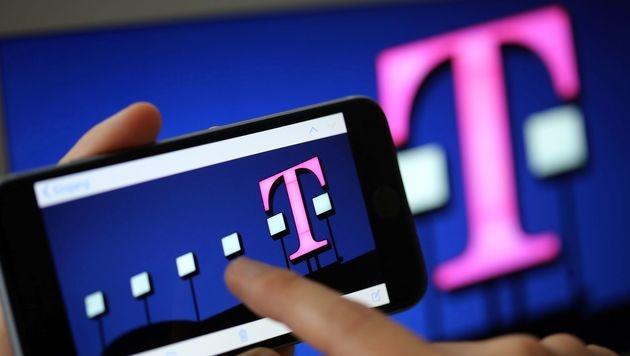 T-Mobile muss 44 Millionen Euro Strafe zahlen (Bild: APA/AFP/dpa/OLIVER BERG)