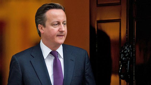 Cameron gibt auch Sitz im Parlament auf (Bild: APA/AFP/LEON NEAL)
