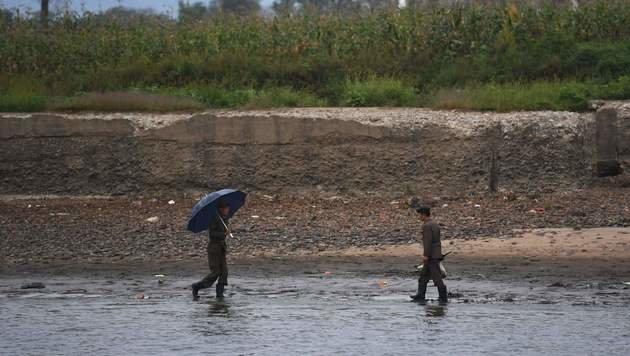 Anhaltende Regenfälle in den vergangenen Wochen hatten schwere Überschwemmungen zur Folge. (Bild: APA/AFP/GREG BAKER)