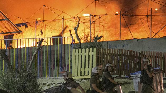 Lesbos: Festnahmen nach Brand in Fl�chtlingslager (Bild: Associated Press.)